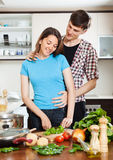 Man flirting with pretty girl in  kitchen Royalty Free Stock Image