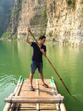 Man floating on a bamboo raft Royalty Free Stock Images