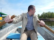 A man floating on a boat rides with royalty free stock image