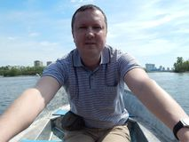 A man floating on a boat rides with royalty free stock images