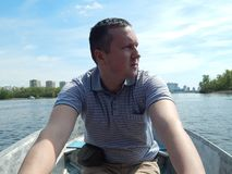A man floating on a boat rides with royalty free stock photography
