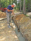 Man floating concrete footer. Man floating concrete foundation footer Royalty Free Stock Images