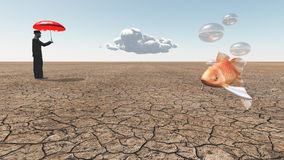 Man and floating fish. In desert Royalty Free Stock Image