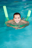 Man floating. Happy man inside of the pool stock photos