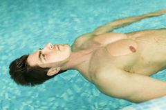 Man floating in the pool. Face of the man floating in the pool Royalty Free Stock Photos