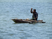Man floating in the river by boat, Sri Lanka. Man floating in the river by boat Stock Photos