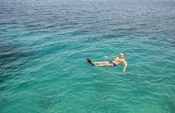 Man floating in the sea. Stock Photo