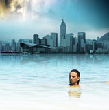 Man floating in tropical water Royalty Free Stock Photography
