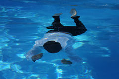 Man floating in the water Stock Images