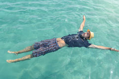 man floating on the water. Summer relaxation Stock Photos