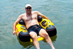 Man Floating in Water/Tube stock photo