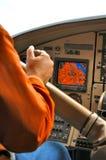 Man in floatplane cockpit Stock Photography
