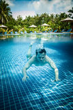 Man floats underwater in pool Royalty Free Stock Photos