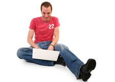 Man on Floor with Laptop royalty free stock images