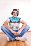 Man on the floor listening  music Stock Images