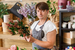 Man florist assistant in flower shop delivery make bouquet royalty free stock photos