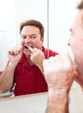 Flossing Teeth In Bathroom Mirror Royalty Free Stock Photos