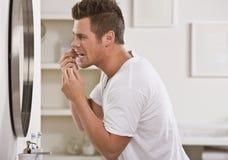 Man Flossing Teeth Royalty Free Stock Photos