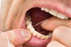 Man flossing teeth Royalty Free Stock Image