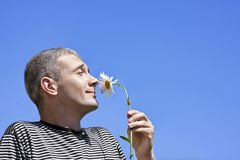 The man and a flower Stock Photography