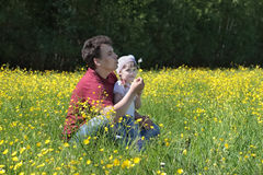 Man with flower and daughter Stock Images