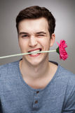 Man with flower in his mouth Royalty Free Stock Photos
