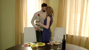 Man with flower meeting woman. Couple sitting at the table. First date ideas stock footage