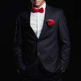 Man with flower preparing for a date. young groom man. In suit.elegant boy without face Royalty Free Stock Photos