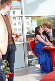 Man with flower unlucky in love. Restaurant. Man propose marriage to beautiful girl in restaurant. Valentines day Stock Photos