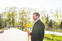 Man with flower waiting his woman - the romantic date or valentines day concept Stock Photography