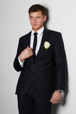 Man with flower. young groom man in suit Stock Photo