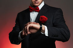 Man with flower.young groom man in suit stock photo