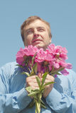 Man and flowers. Stock Photos