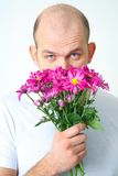 Man with flowers Royalty Free Stock Image