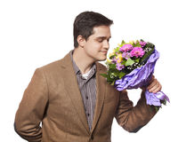 Man with flowers Stock Photography