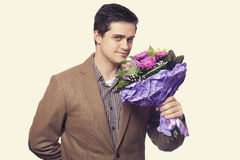 Man with flowers Stock Photos