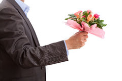 Man with flowers on a date Royalty Free Stock Images