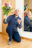 Man with flowers. Guilty man asks forgiveness with bouquet of flowers stock photography