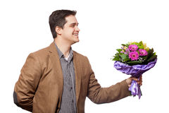 Man with flowers in hand Stock Photo
