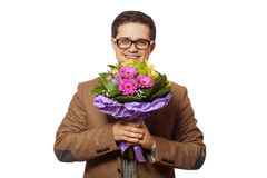 Man with flowers in hand Royalty Free Stock Photography