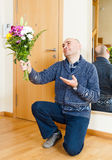 Man with flowers. Royalty Free Stock Images