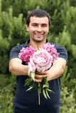 Man with flowers peony Royalty Free Stock Images