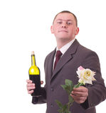 Man with flowers and wine bottle Royalty Free Stock Photography
