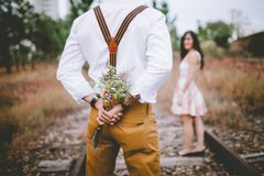 Man with flowers for woman Stock Image