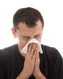 Man with a flu. Young man with flu blowing nose Stock Images