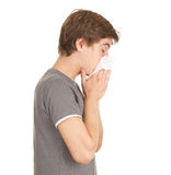 Man with flu blowing her nose. Sick young man with flu blowing her nose Royalty Free Stock Photos