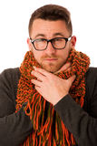 Man with flu and fever wrapped in scarf has terrible sore throat Stock Image