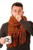 Man with flu and fever wrapped in scarf holding cup of healing t Royalty Free Stock Image