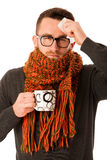 Man with flu and fever wrapped in scarf holding cup of healing t Royalty Free Stock Photo
