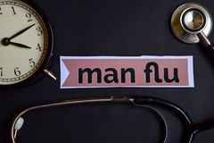 Man Flu on the print paper with Healthcare Concept Inspiration. alarm clock, Black stethoscope. stock photos